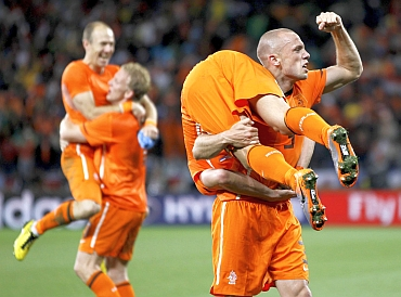 Netherlands' John Heitinga celebrates with Wesley Sneijder, Arjen Robben and Dirk Kuyt at Green Point stadium