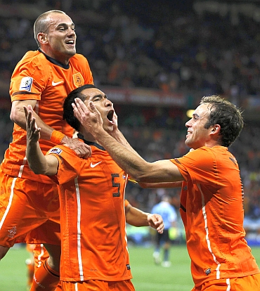 Van Bronckhorst celebrates after scoring