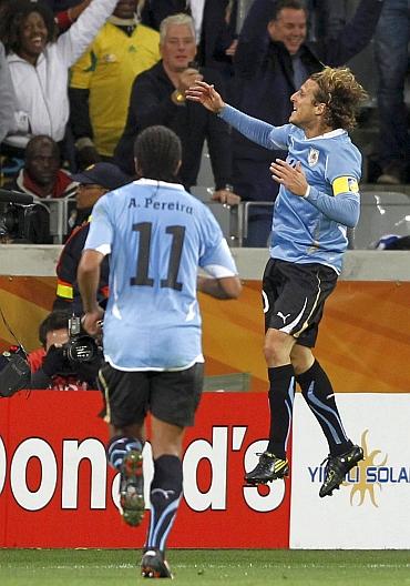 Diego Forlan celebrates after scoring
