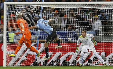 Arjen Robben heads the ball into the net