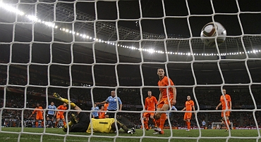Uruguay's Pereira scores a goal past Netherlands' goalkeeper Stekelenburg