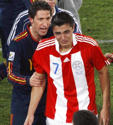Paraguay's Oscar Cardozo (front) cries as he leaves the pitch