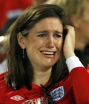 An England fan in tears after the loss against Germany