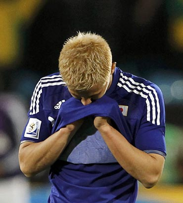 Japan's Keisuke Honda is disappointed after the loss against Paraguay