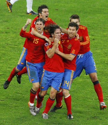 Carlos Puyol celebrates after scoring against Germany