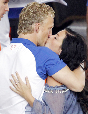 Netherlands' player Dirk Kuyt kisses his wife Gertrude at the Sandton Hilton hotel in Johannesburg
