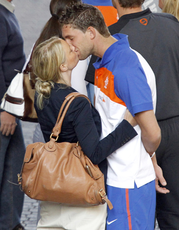 Netherlands' Stekelenburg kisses his partner outside the Sandton Hilton hotel in Johannesburg