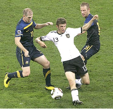 Thomas Mueller (in white)