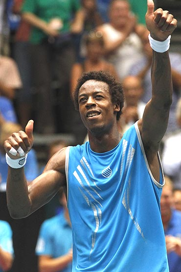 Gael Monfils of France celebrates after beating David Ferrer of Spain during their Davis Cup World group quarter-final match
