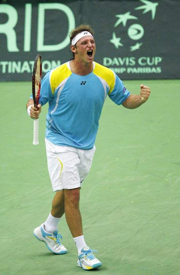 Argentina's Nalbandian celebrates his victory during their Davis Cup World Group quarter-final match