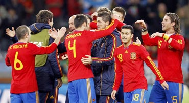Spain team celebrates after beating Germany