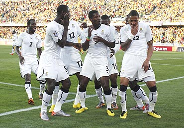 Gyan (centre) dances with his Ghana teammates