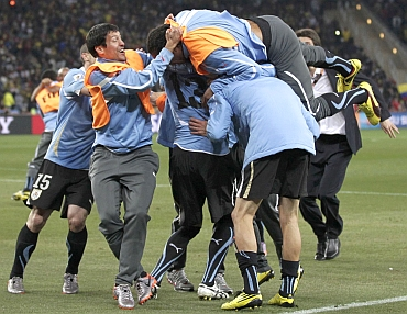 Uruguay players celebrate after winning a match
