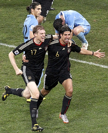 Germany's Sami Khedira (R) celebrates with team mate Per Mertesacker after scoring against Uruguay