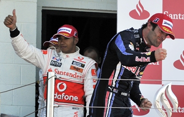 Webber (R) and McLaren driver Lewis Hamilton celebrates on the podium