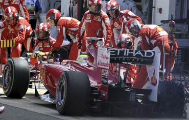 Ferrari Formula One driver Massa of Brazil has a puncture changed during
