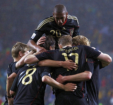 Germany team celebrate after winning the match