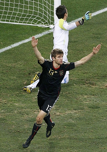 Germany's Thomas Mueller celebrates after scoring the first goal