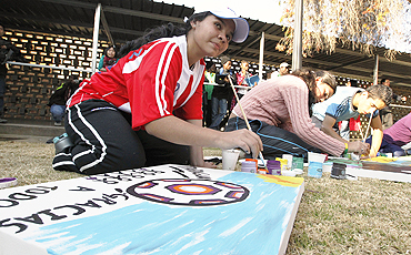 Participants paint at a workshop to promote the Football for Hope programme at the Queen's High School in Johannesburg