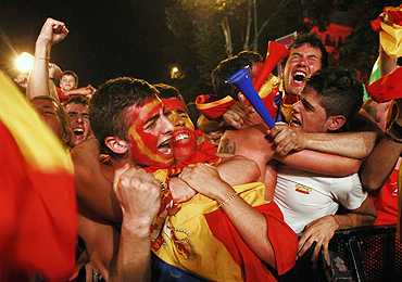 Spanish fans celebrate after the World Cup victory in Madrid
