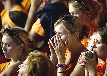 Dutch fans wear a dejected look in Amsterdam