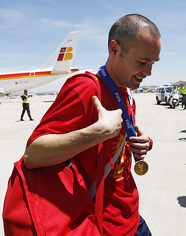 Spain's soccer player Andres Iniesta arrives at Madrid's Barajas airport