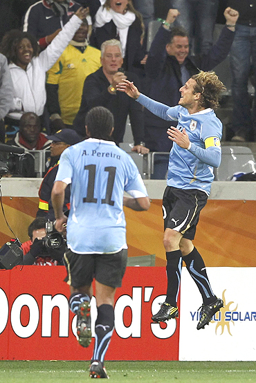 Diego Forlan celebrates after scoring against the Dutch