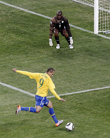 Brazil's Luis Fabiano scores past Ivory Coast's goalkeeper Boubacar Barry
