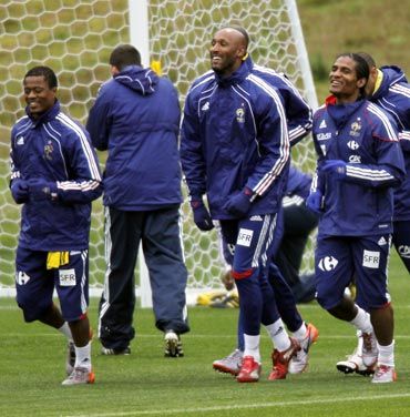 France captain Patrice Evra (left) with Nicolas Anelka (centre) and Florent Malouda train during the 2010 World Cup