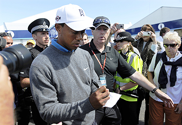 Tiger Woods signs autographs in St Andrews, Scotland