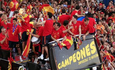 Spain's players celebrate their World Cup victory on an open-top bus during a parade in downtown Madrid