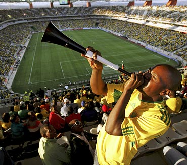 A South African fan blows the vuvuzela