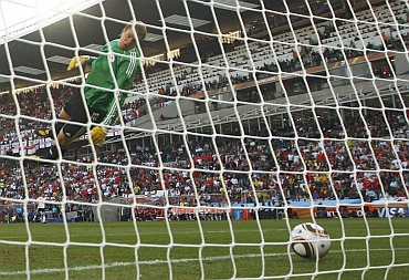 Germany's goalkeeper Manuel Neuer watches as the ball crosses the line during their match against England