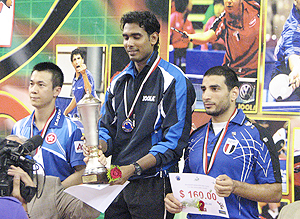 Sharath Kamal on the podium after winning the Egypt Open
