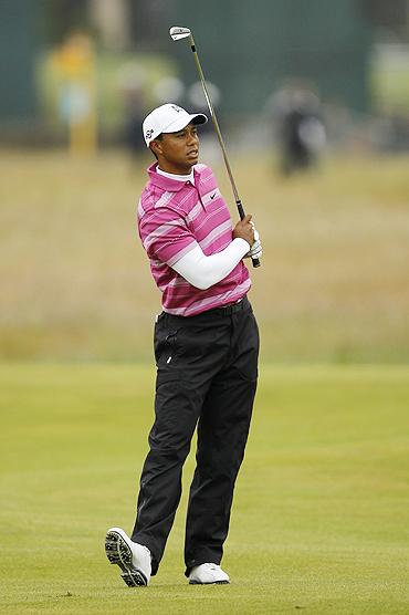 Tiger Woods watches his approach shot to the second green during first round of play at the British Open golf championship St Andrews, Scotland, on Thursday
