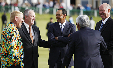 Tiger Woods (centre) chats with John Daly, Mark Calcavecchia, Lee Trevino and Tom Weiskopf before a photo-op atthe Old Course in St Andrews, Scotland