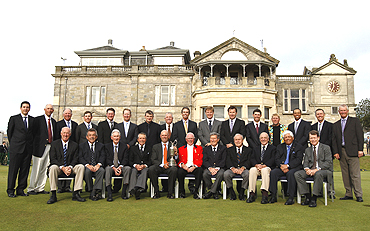 Past winners of the British Open golf championship pose in front of the clubhouse on the Old Course in St Andrews