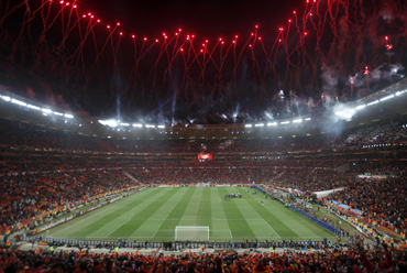 Fireworks explode over the Soccer City stadium during celebrations after the 2010 World Cup final match