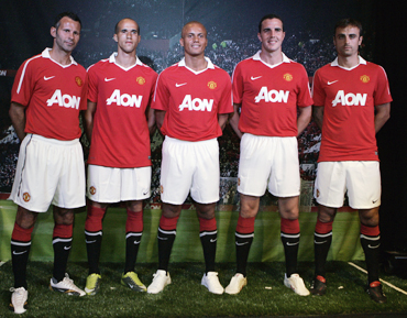 Manchester United players wear the new team jersey during its debut in Chicago