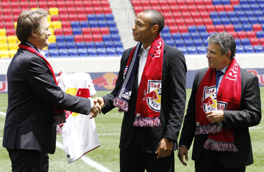 France striker Thierry Henry (centre) shakes hands with head of Red Bulls Global Soccer Dietmar Beiersdorfer in Harrison