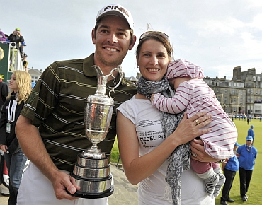 Louis Oosthuizen with his wife Nel-Mare and daughter Jana after winning the British Open