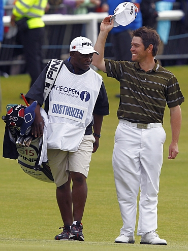 Louis Oosthuizen celebrates with his caddie Zack Rasego after winning the British Open