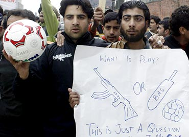 Football players protest against the government's plans to convert a playground into a flower garden in Srinagar