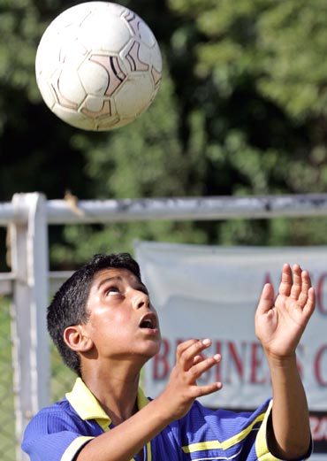 A young boy trains at the polo ground in Srinagar