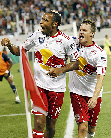 New York Red Bulls' Thierry Henry celebrates with team-mate after he scoring against Spurs