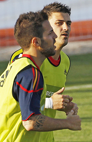 Cesc Fabregas (left) and David Villa