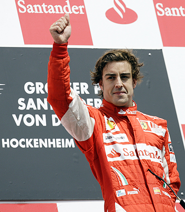 Fernando Alonso on the podium after winning the German GP on Sunday