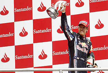 Red Bull's Sebastian Vettel celebrates on the podium