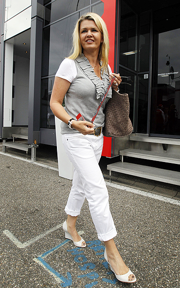 Corinna Schumacher, wife of Michael Schumacher walks through the paddock before the race on Sunday