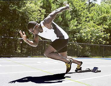 Former Olympic gold medallist sprinter Justin Gatlin warms up at a track in Marietta, Georgia